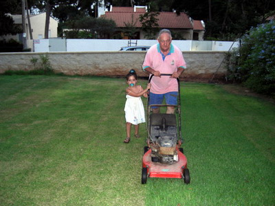 Helping to mow the lawn